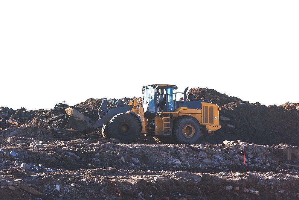 USA, New York State, New York City, Bulldozer on garbage dump
