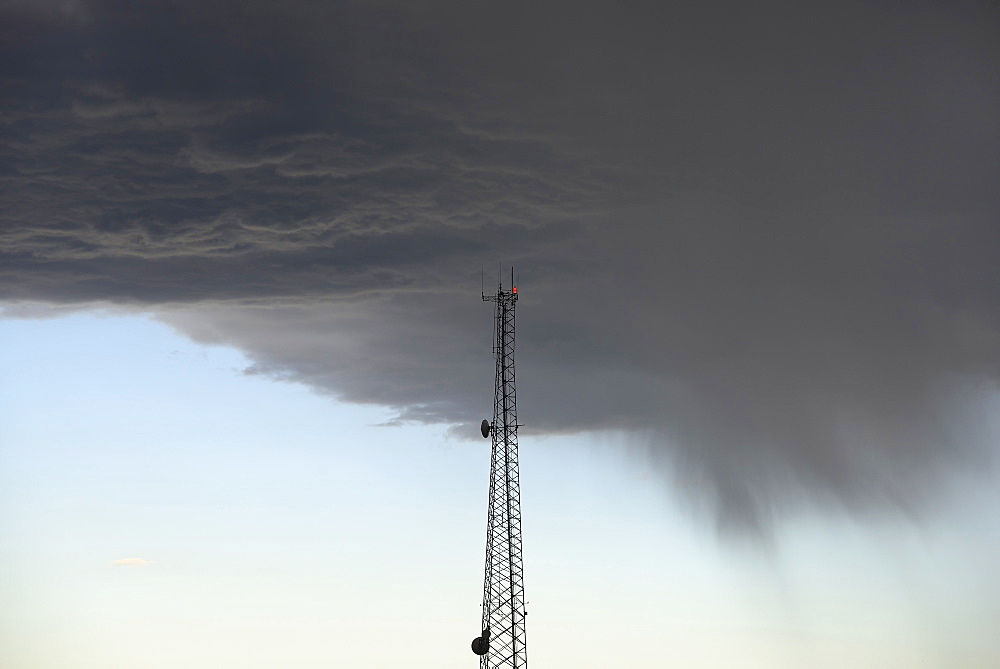 Storm clouds gathering above communications tower