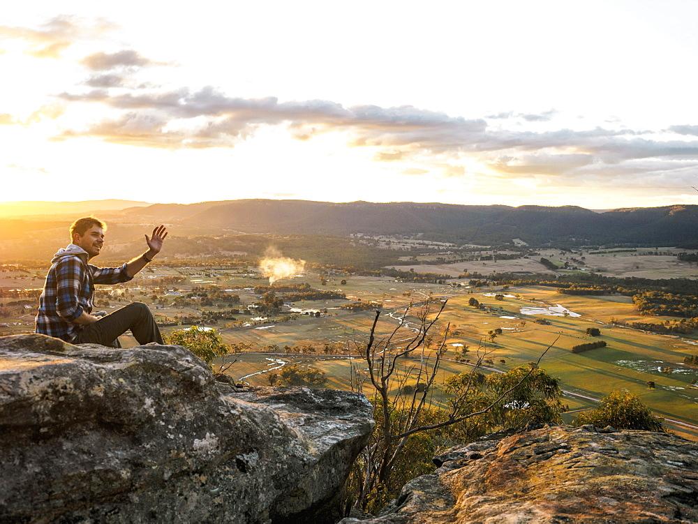 Australia, New South Wales, Man waving on Mount York