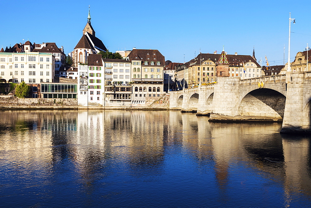 Switzerland, Basel, Basel-Stadt, Houses by Rhine River and stone bridge