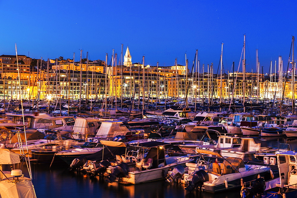 France, Provence-Alpes-Cote d'Azur, Marseille, Crowded Vieux port - Old Port at dusk