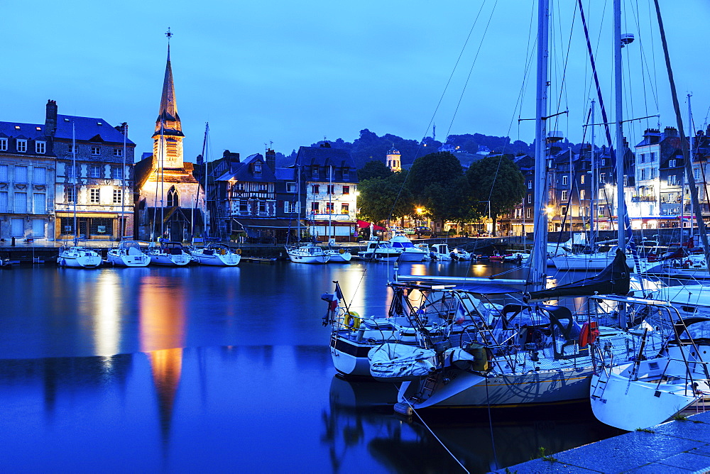 France, Normandy, Honfleur, Boats in harbor and Saint-Etiennei Church in distance