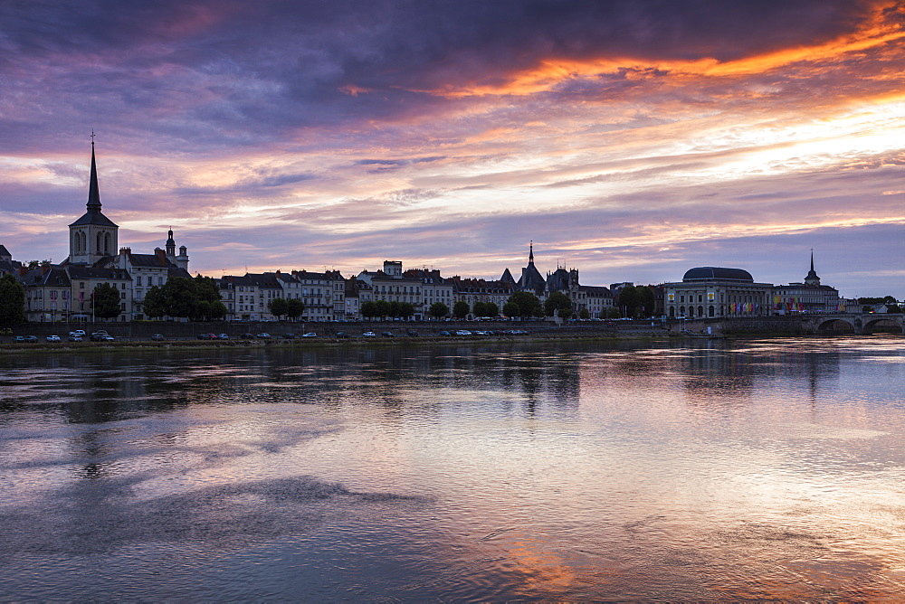 France, Pays de la Loire, Saumur, City waterfront at sunset