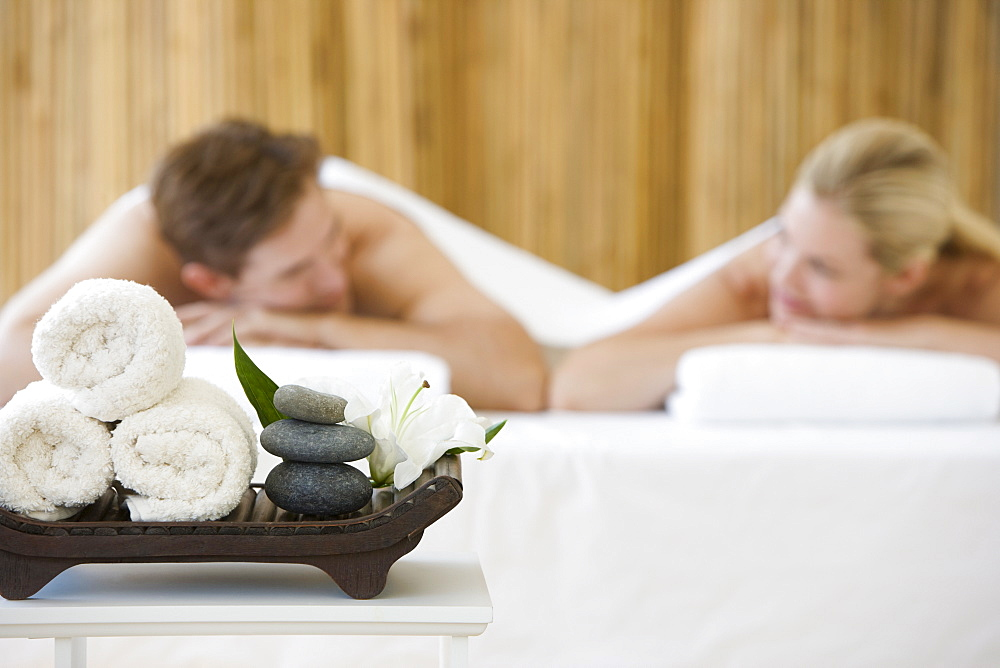 Couple receiving spa treatment