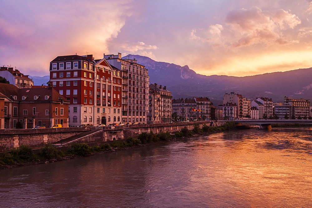 France, Auvergne-Rhone-Alpes, Grenoble, Grenoble architecture along Isere River seen at sunset