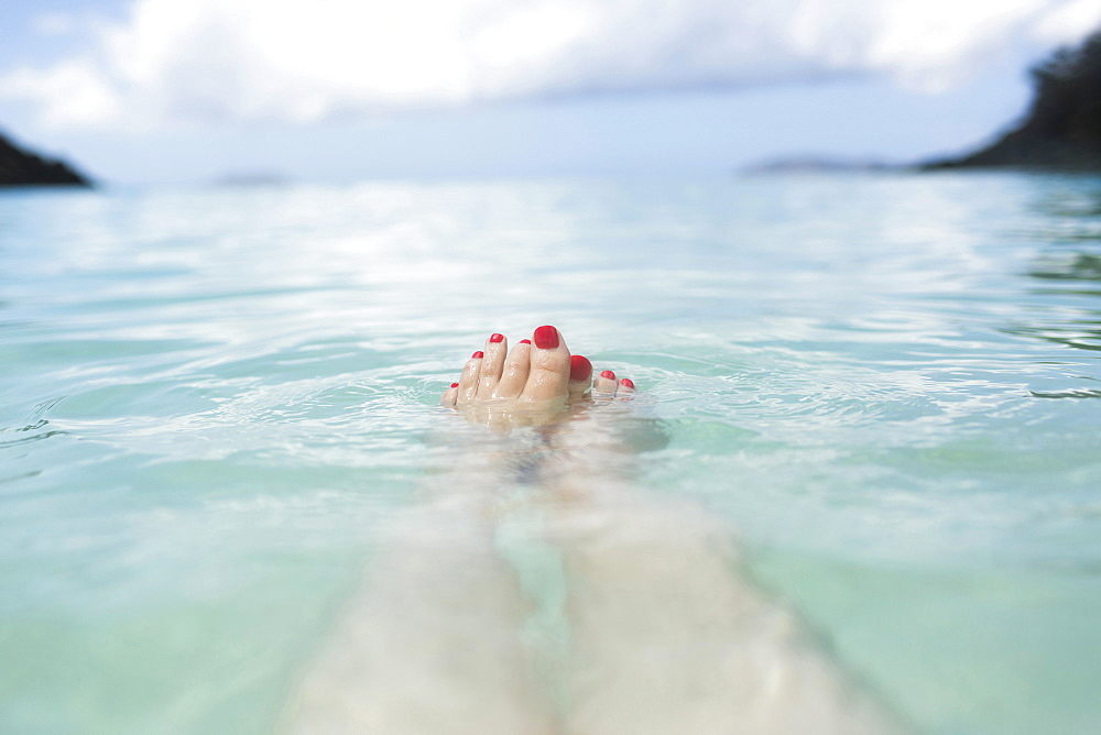 USA, Virgin Islands, Saint Thomas, Female feet in sea
