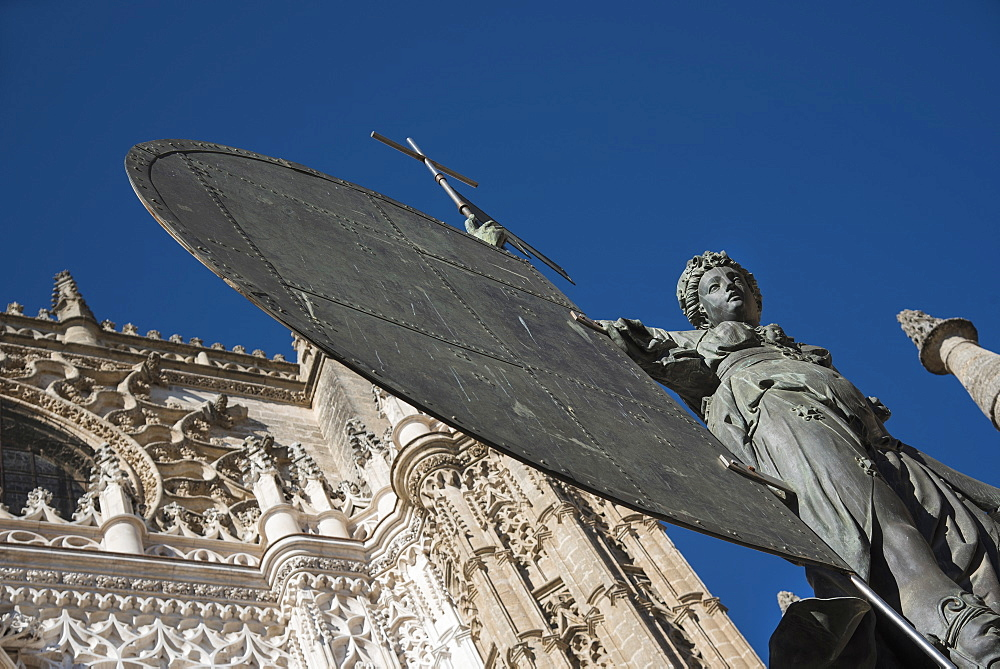 Spain, Seville, Facade of Cathedral of Seville with statue