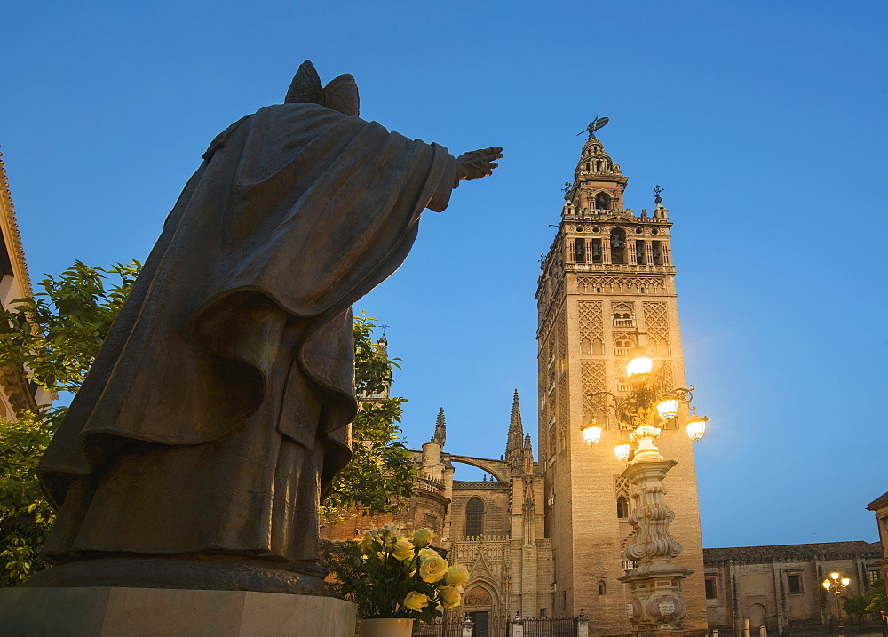 Spain, Seville, Plaza Virgin De Los Reyes, Statue and Girlada Tower