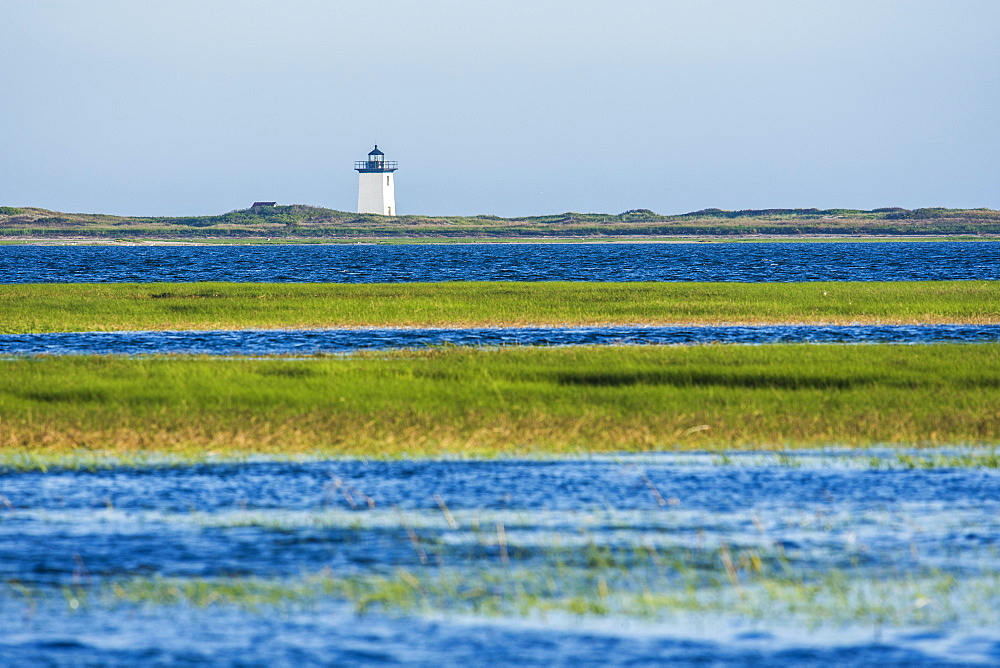 USA, Massachusetts, Cape Cod, Provincetown, Bay of water with lighthouse