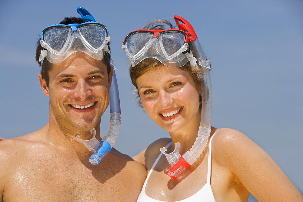 Couple wearing snorkeling gear