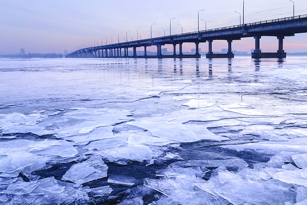 Ukraine, Dnepropetrovsk region, Dnepropetrovsk city, Bridge over frozen river