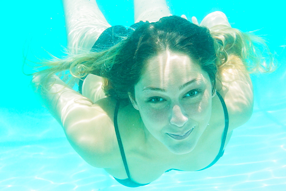 Underwater portrait of woman in swimming pool