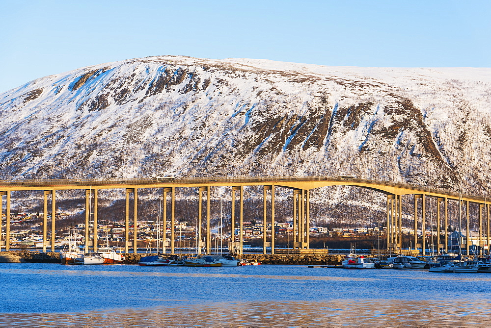 Bridge by snow covered hill in Tromso, Norway
