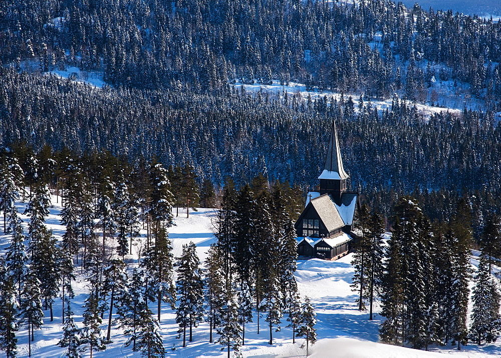 Church in forest during winter in Oslo, Norway