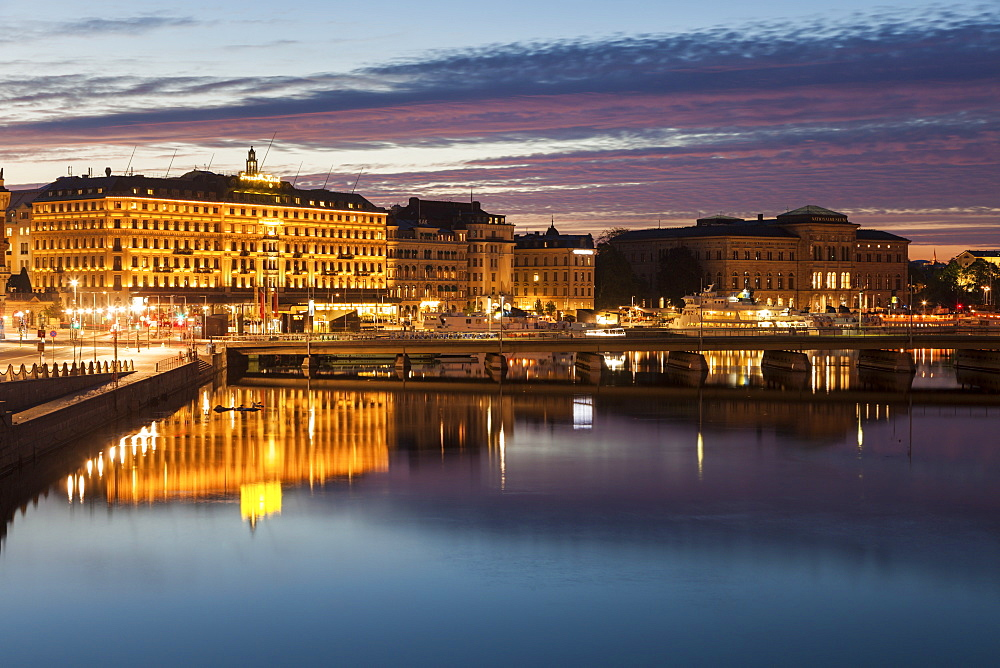 Buildings by river at sunset in Stockholm, Sweden
