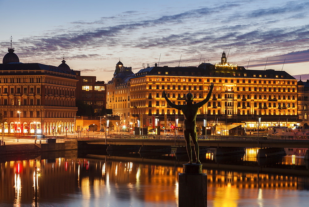 Statue by buildings at sunset in Stockholm, Sweden