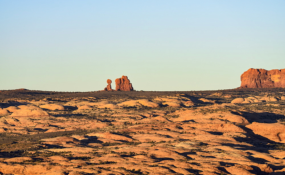 Sand dunes and Balanced Rock in Arches National Park, Utah, USA