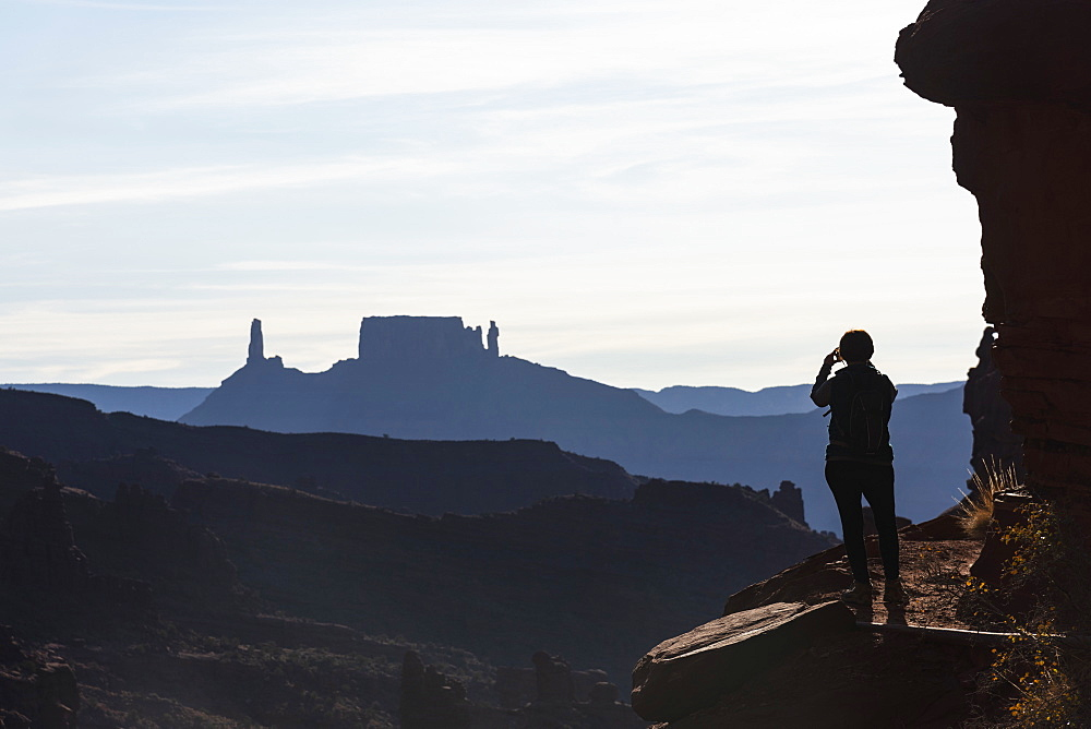 Woman's silhouette by Fisher Towers in Utah, USA