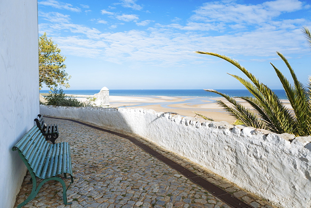 Benches on footpath by beach in Cacela, Portugal
