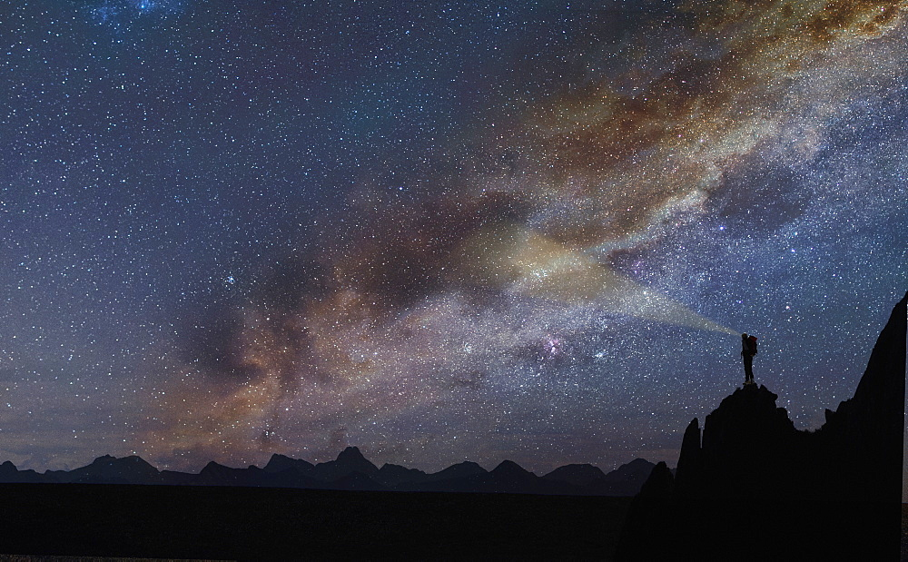 Silhouette of rocks under starscape in the Dolomites, South Tyrol, Italy
