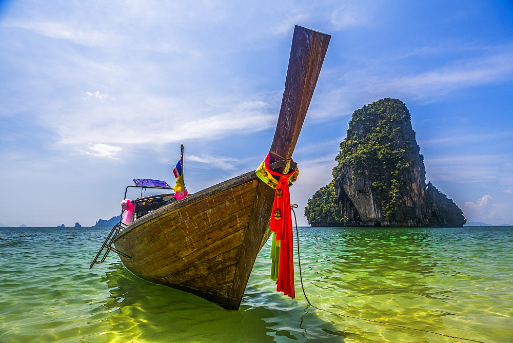 Boat by rock island in West Railay, Thailand