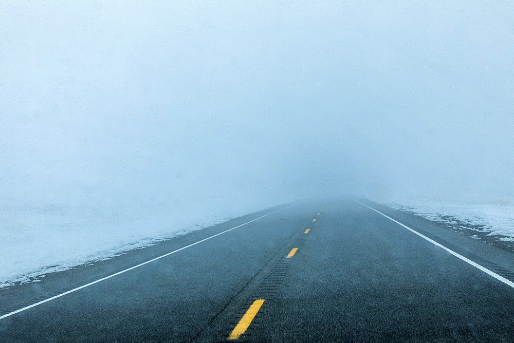 Fog over road with snow