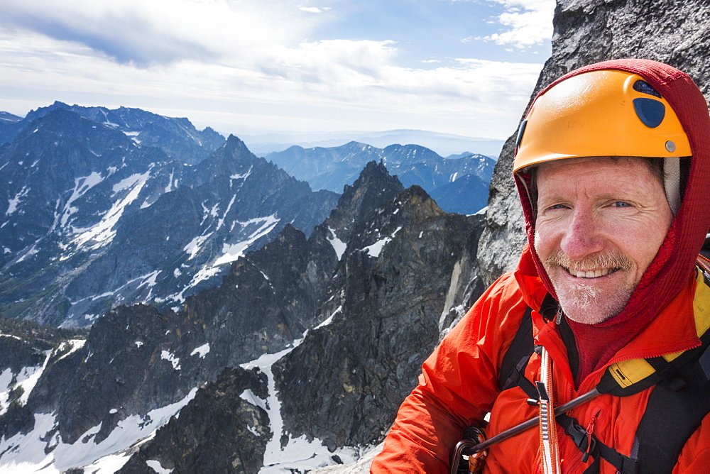 Mature man mountain climbing on Mount Stuart in North Cascade Mountains, Washington, USA
