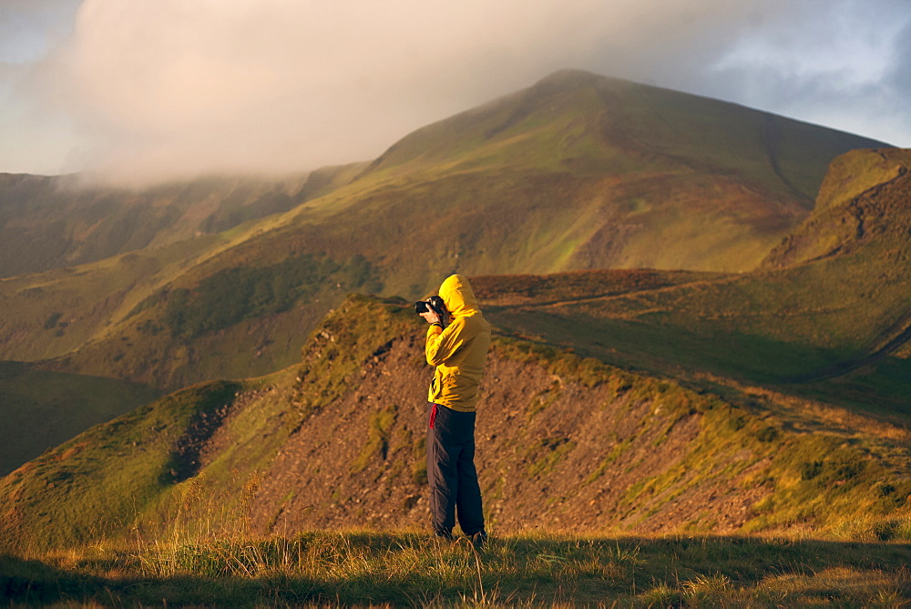 Man in yellow jacket taking photographs in the Carpathian Mountain Range