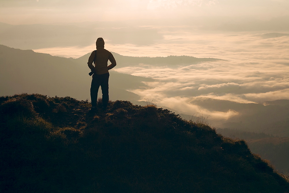 Silhouette of man in the Carpathian Mountain Range at sunrise
