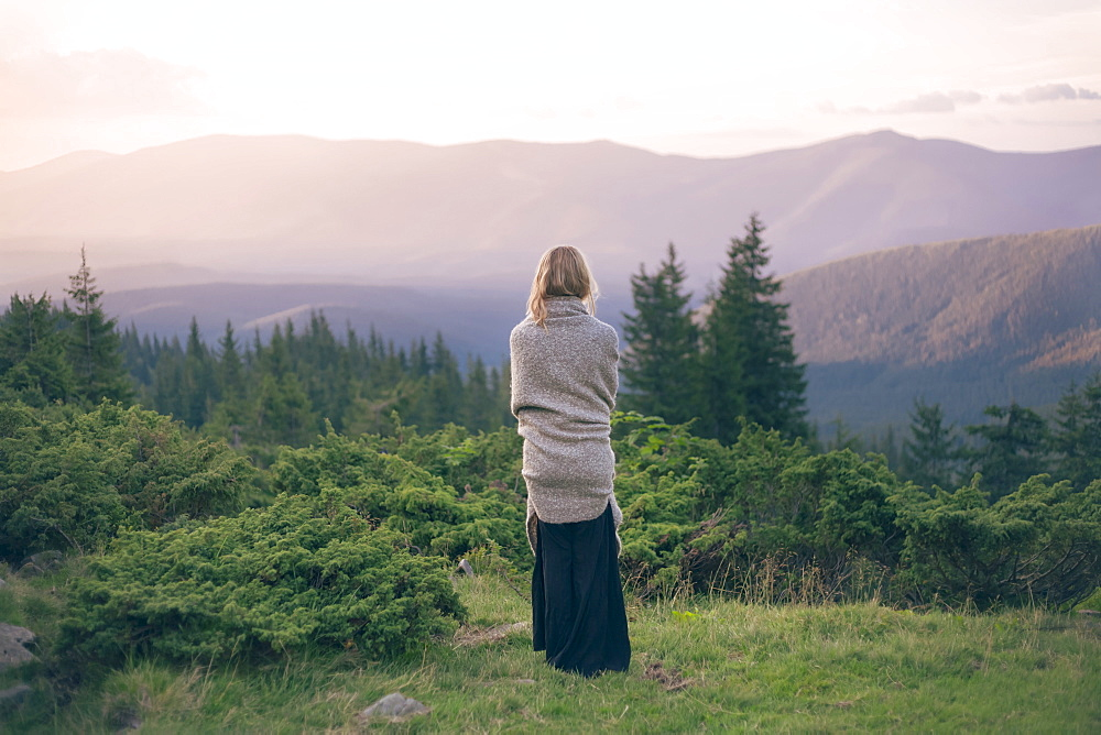 Woman wrapped in blanket in the Carpathian Mountain Range