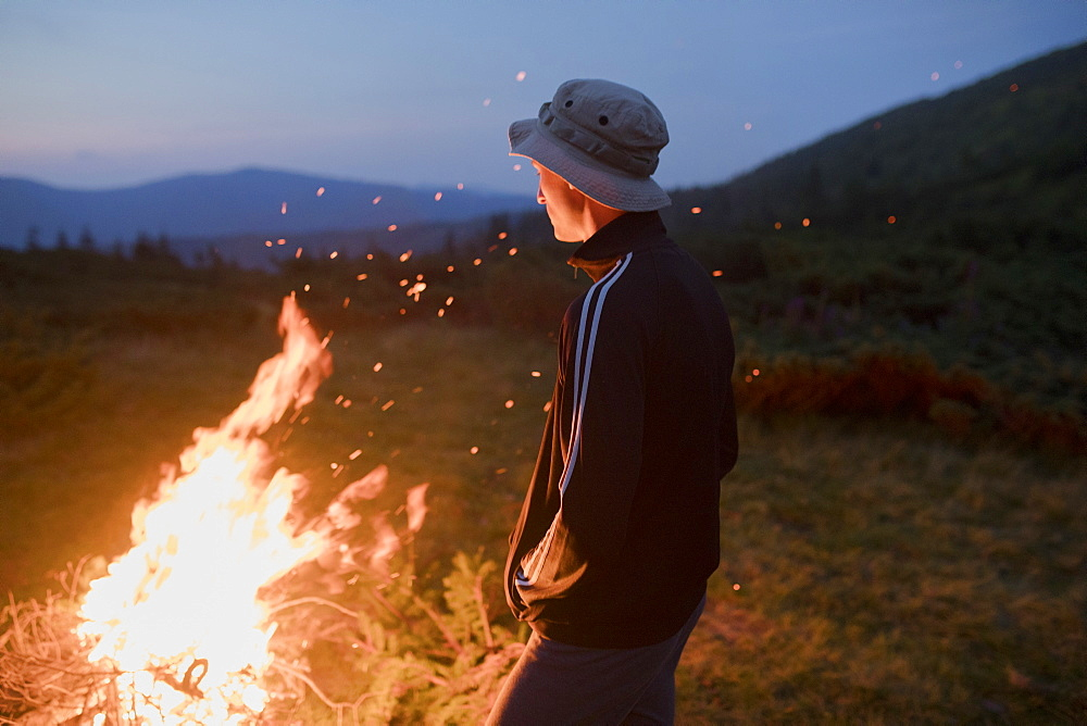 Man by campfire
