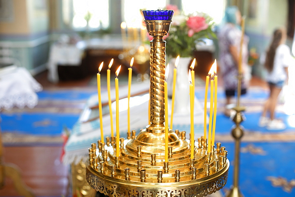Candle holder in church during wedding