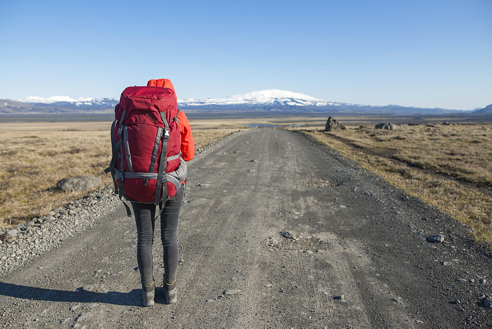 Hiker on road in Fjallabak Nature Reserve in Iceland