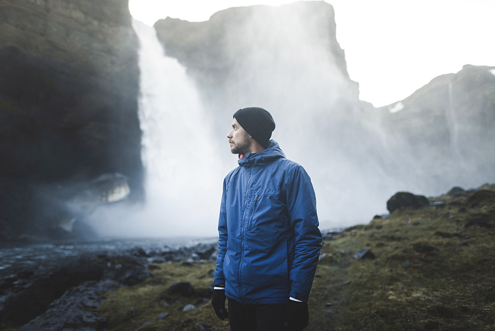 Hiker by Haifoss waterfall in Iceland