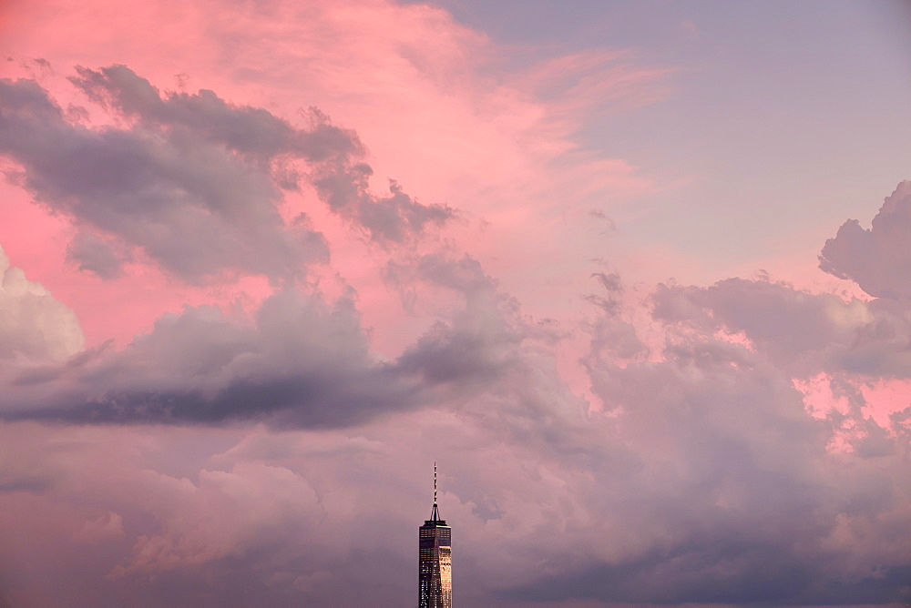 Freedom Tower against sky at sunset in New York City, USA