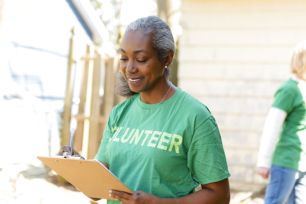 Mature woman volunteer with clipboard