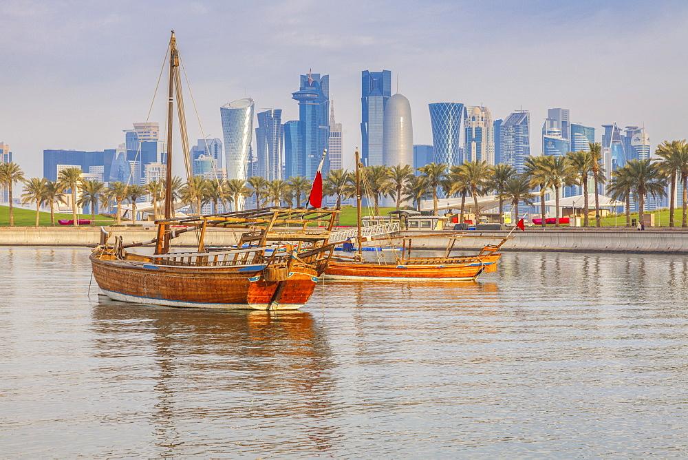 Boats by skyscraper skyline in Doha, Qatar