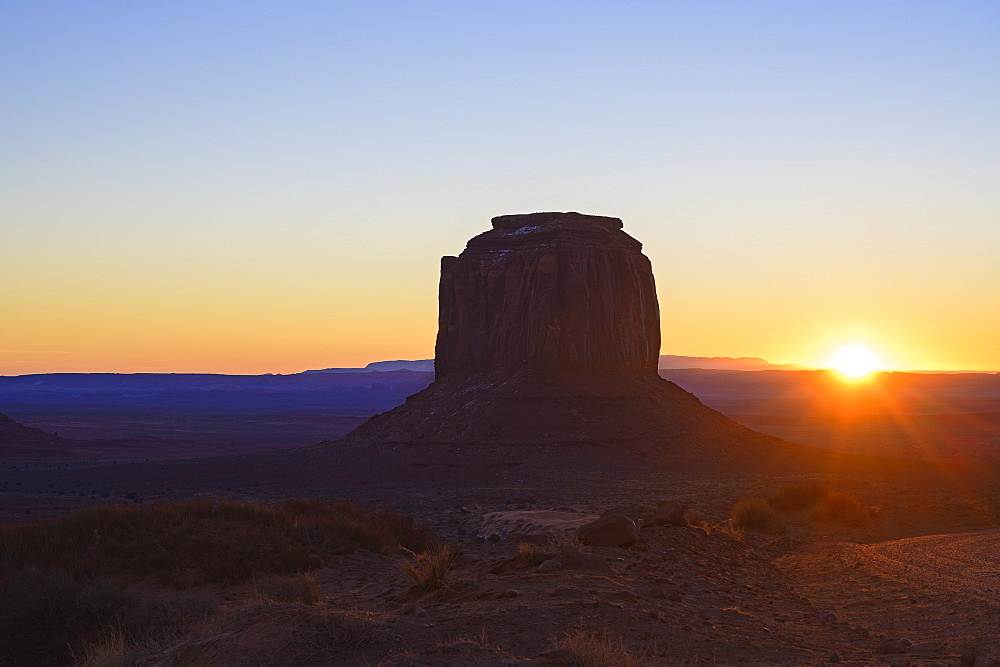 Butte at sunset in Monument Valley, Arizona, USA