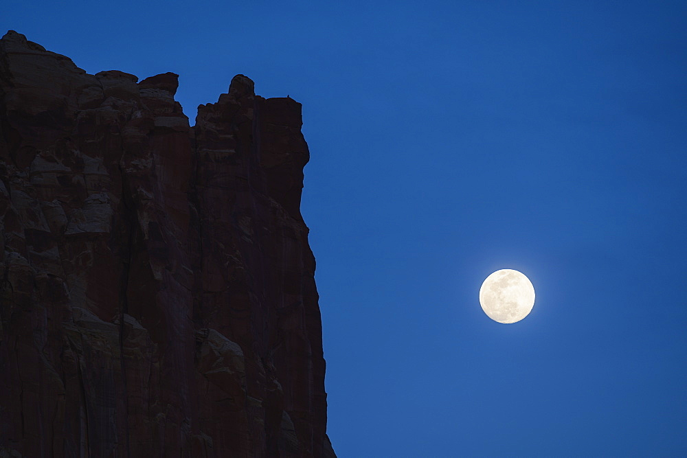 Cliff by full moon in Capitol Reef National Park, USA