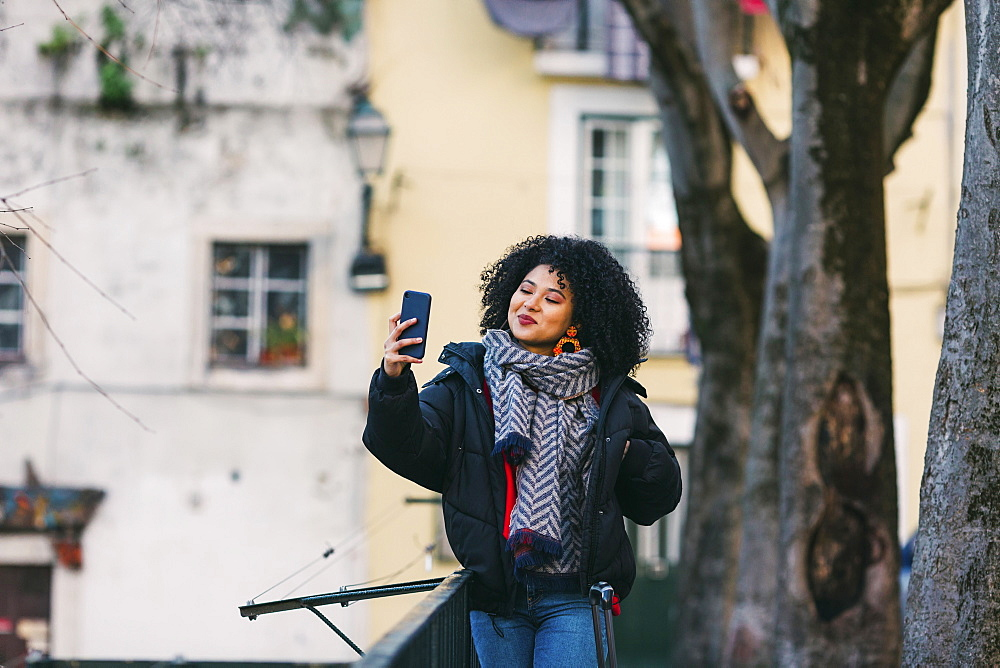Young woman taking selfie in Lisbon, Portugal