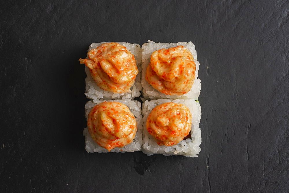 Sushi with orange sauce