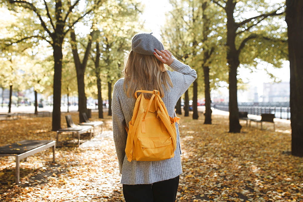 Young woman with yellow backpack in park in Berlin, Germany - 1178-27106