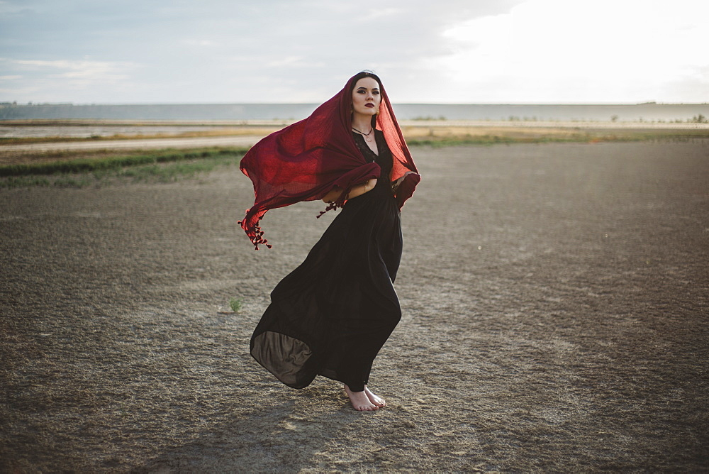 Windswept woman wearing red headscarf