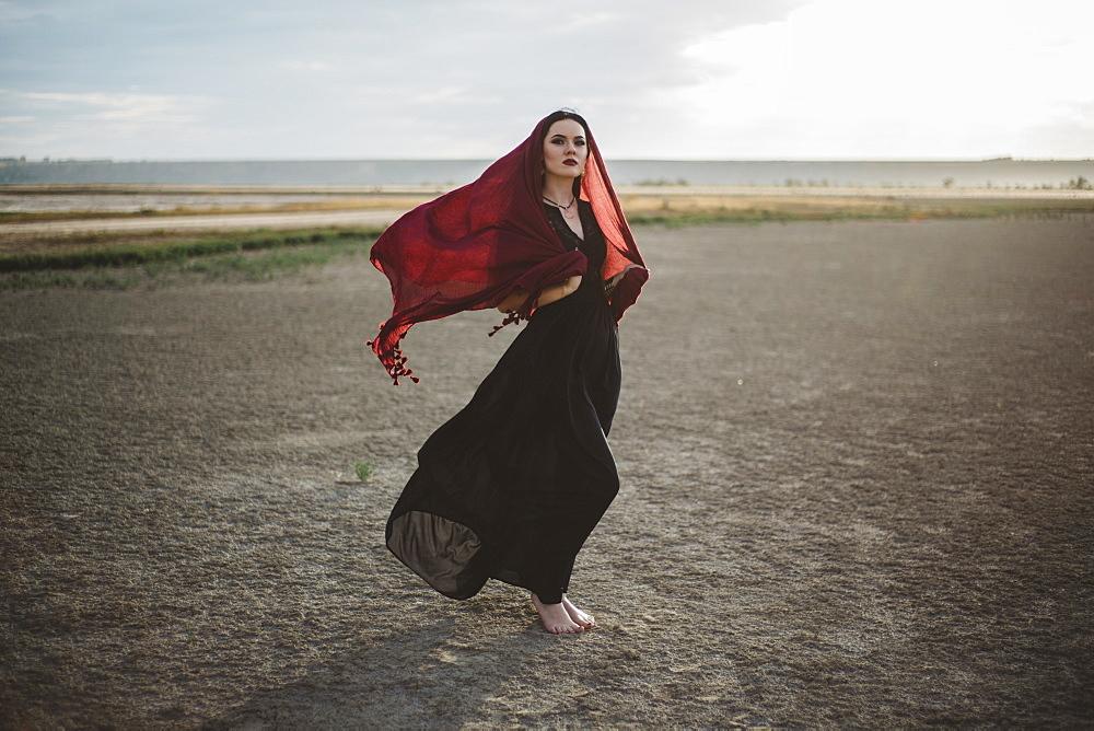 Windswept woman wearing red headscarf