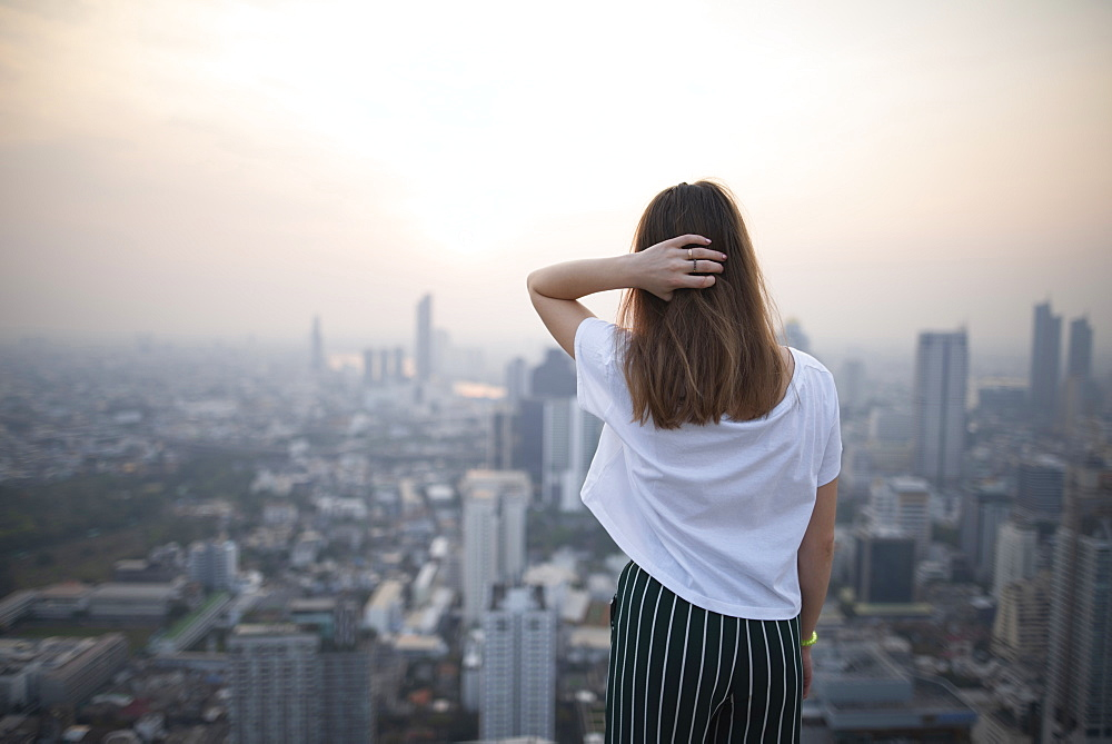 Young woman and cityscape of Bangkok, Thailand