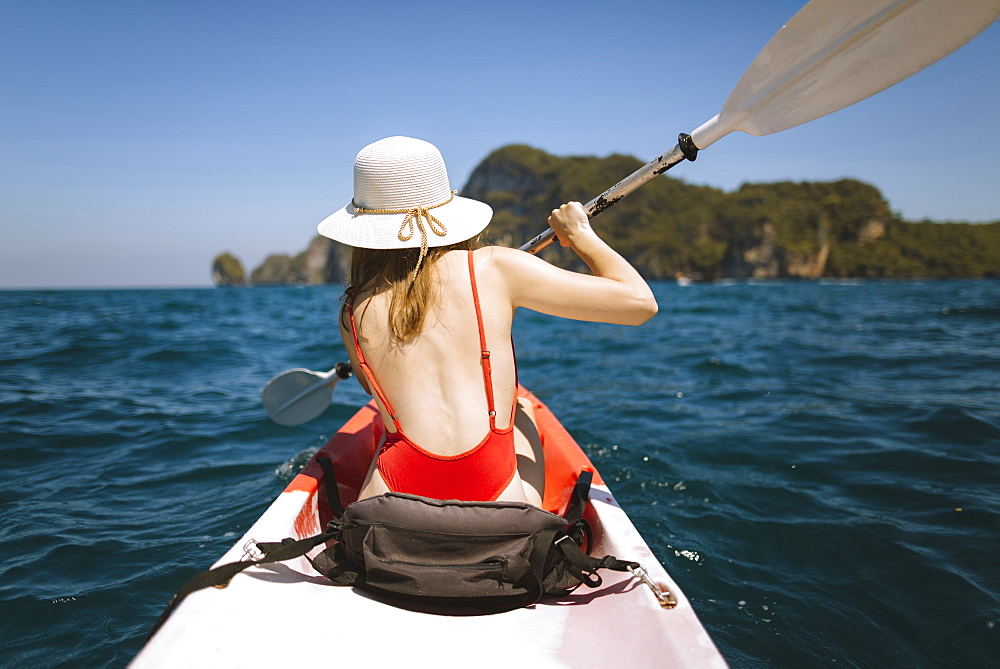 Young woman in kayak on sea in Krabi, Thailand