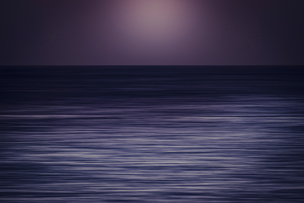Gray seascape at sunset