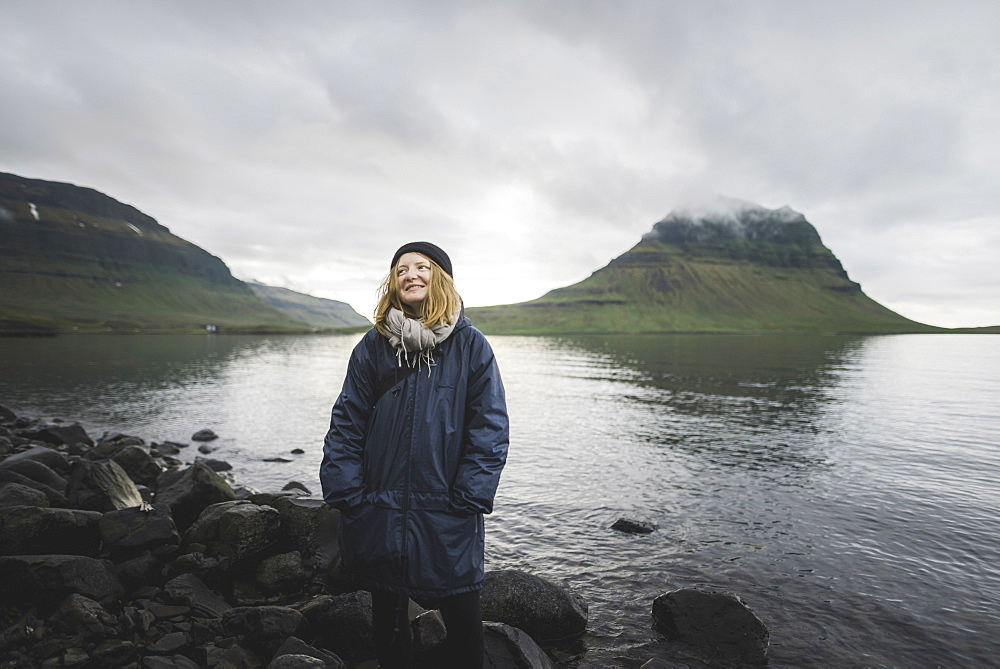 Smiling woman by Kirkjufell in Iceland