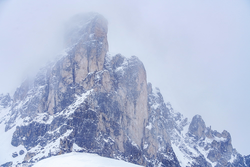 Ra Gusela mountain peak in fog in Dolomites, Passo Giau, Belluno, Italy