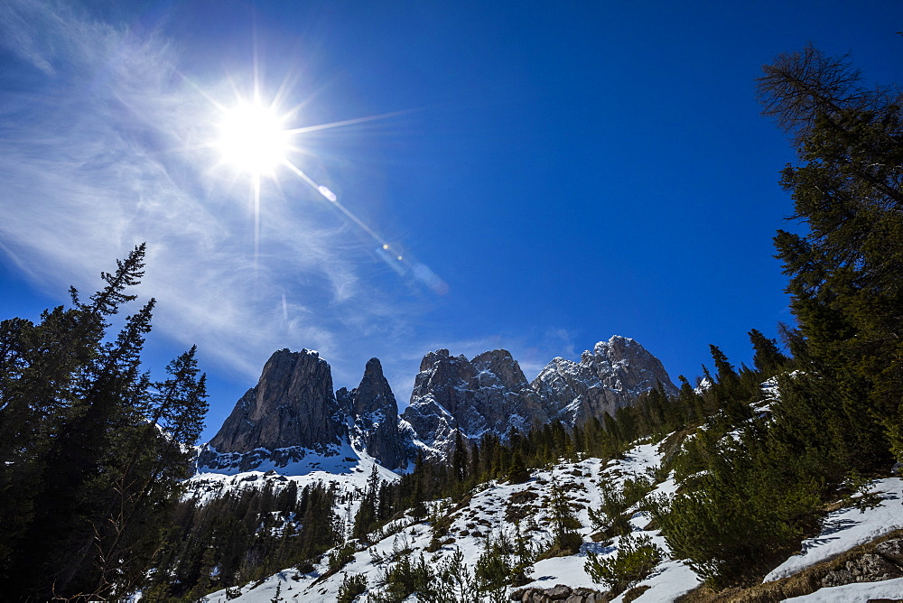 Sun over mountain range in Dolomites, St. Peter, South Tyrol, Italy